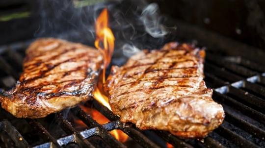 sirloin steaks on a bbq grill